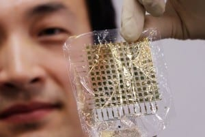 This picture taken on January 22, 2016 shows South Korean researcher Lee Sung-Won of Tokyo University's graduate school of engineering holding a super-thin bendable pressure sensor, developed by professor Takao Someya and his team at his laboratory in Tokyo. The nanofiver type sensor containing carbon nanotubes and graphenes could someday be used in special gloves to detect breast lumps and make a digital record of the exam. A square sheet 4.8 by 4.8 centimetres (1.9 inches) in size has 144 locations that can measure pressure. The sheet is so flexible it can detect pressure changes accurately even when twisted like cloth -- a development claimed as a global first. AFP PHOTO / Yoshikazu TSUNO / AFP / YOSHIKAZU TSUNO
